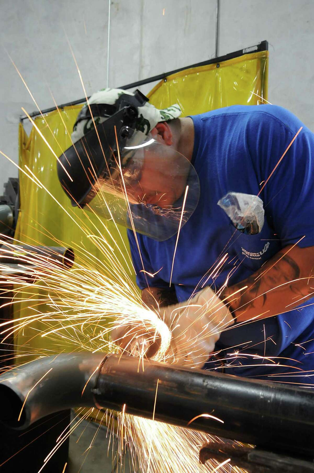 Julio Robles fabricates pipes at Comfort Systems, which plans an online training program.