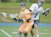 Weston High School's Austin Drimal is stick checked by Newtown High School's Cornelius Dunn during the SWC Division I quarterfinals, played at Newtown High School. Thursday, May 21, 2015