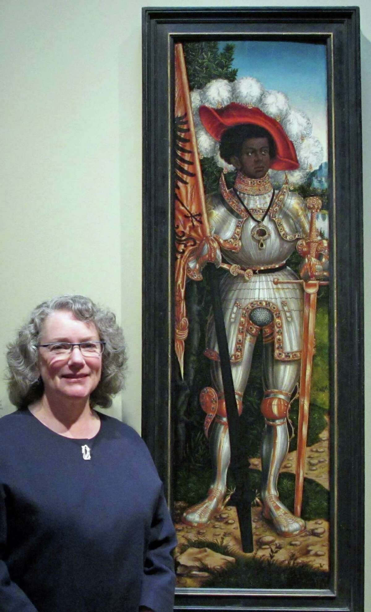 """Old Greenwich resident and Metropolitan Museum of Art Curator Maryan Ainsworth stands before """"Saint Maurice"""" by Lucas Cranach the Elder, at the Met."""