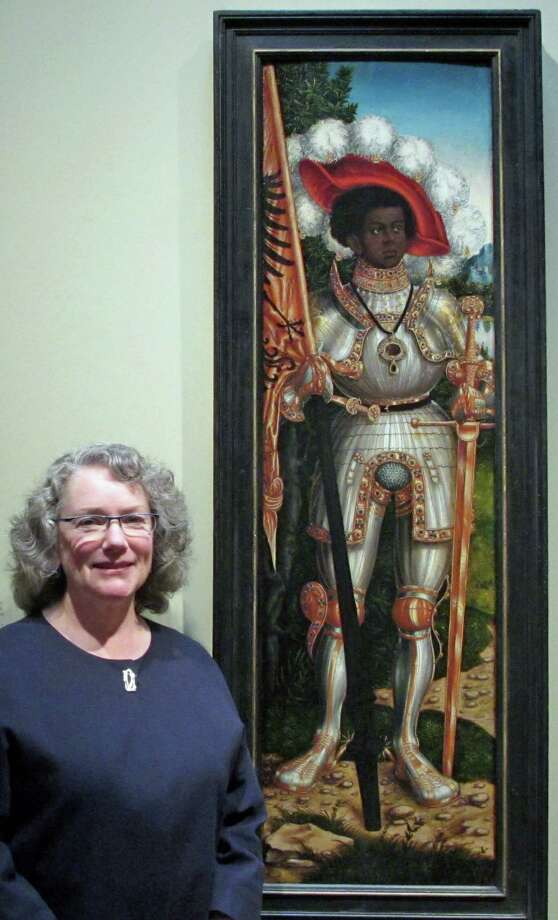 """Old Greenwich resident and Metropolitan Museum of Art Curator Maryan Ainsworth stands before """"Saint Maurice"""" by Lucas Cranach the Elder, at the Met. Photo: Contributed Photo / Greenwich Time Contributed"""