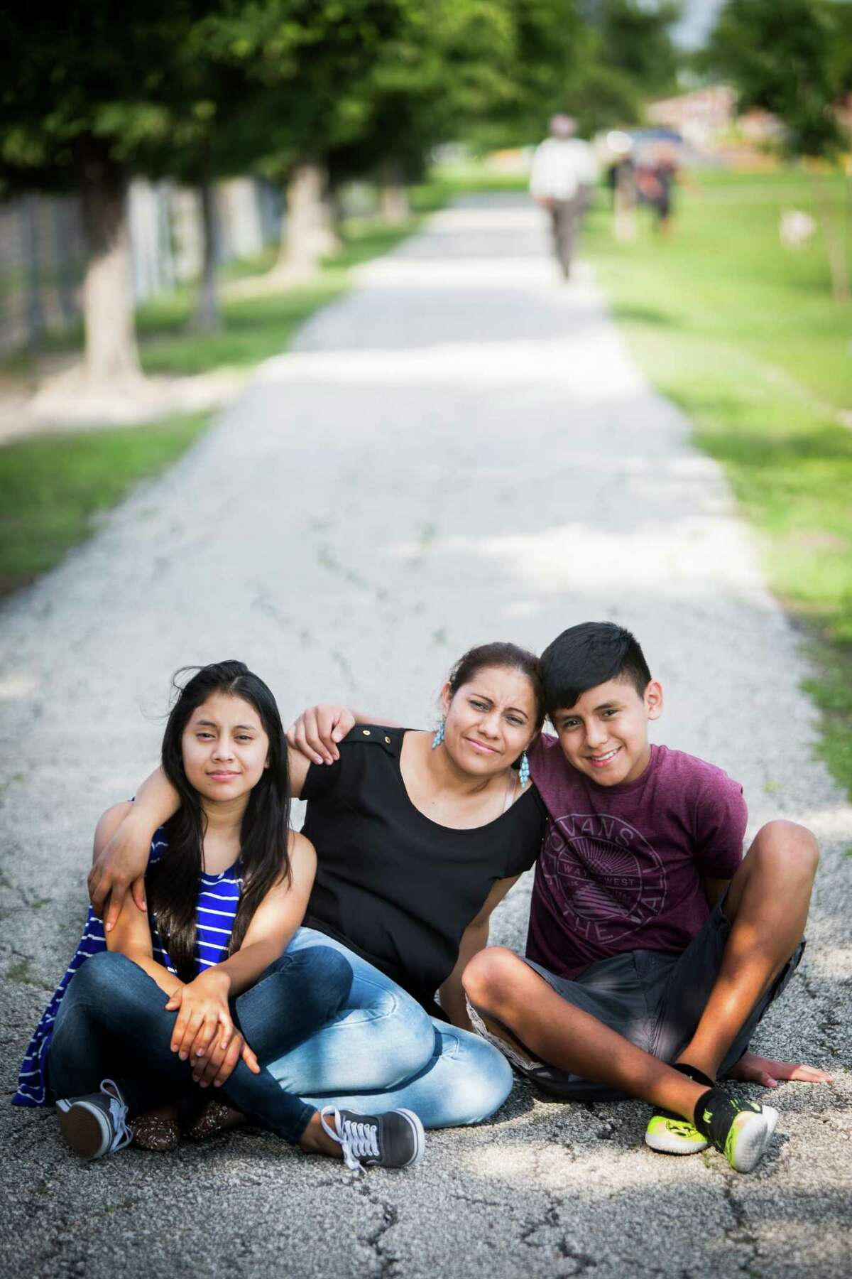Patricia Salazar, came to the United States from Honduras eight years ago to seek a better future for her children, Linneth, 13, left, and Maykol, 14.
