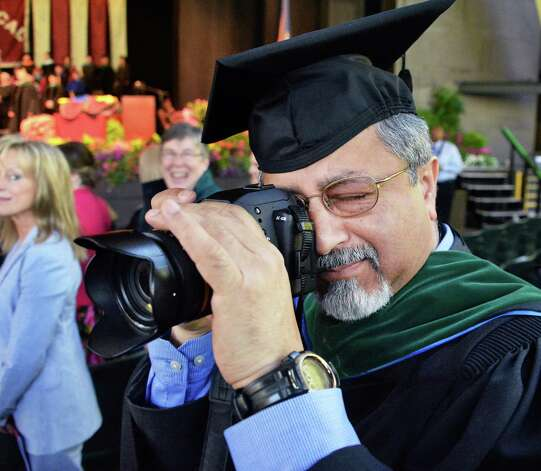 Dr. Gautam Phookan, a Neurosurgeon from Muncie, Indiana photographs his son Sujoy Phookan during Albany Medical College Commencement Thursday May 21, 2015 at SPAC in Saratoga Springs, NY.  (John Carl D'Annibale / Times Union) Photo: John Carl D'Annibale / 00031498A