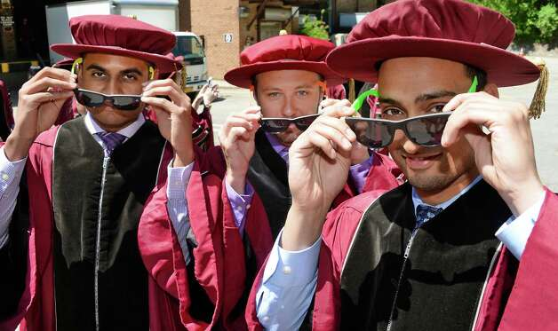 Showing off their sunglasses, from left, Nilay Patel of Manalapan NJ, Gary DeRusso of Saratoga Springs and Jay Agarwal of Narragansett, RI, before the start of Albany Medical College Commencement Thursday May 21, 2015 at SPAC in Saratoga Springs, NY.  (John Carl D'Annibale / Times Union) Photo: John Carl D'Annibale / 00031498A