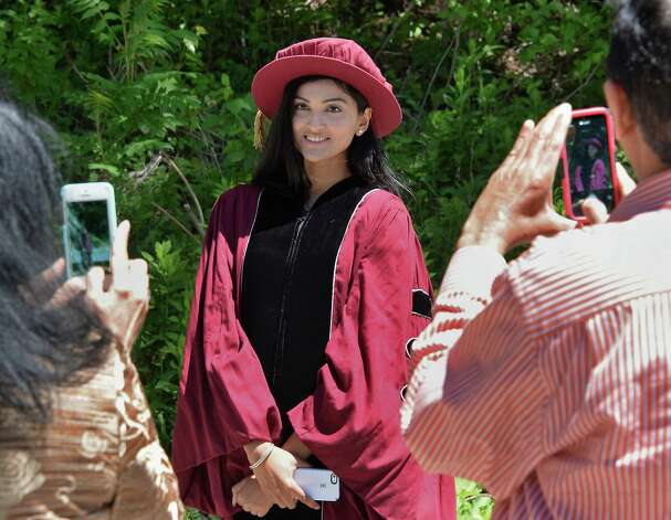 Khusboo Jayendra Desai of Chicago poses for family members before Albany Medical College Commencement Thursday May 21, 2015 at SPAC in Saratoga Springs, NY.  (John Carl D'Annibale / Times Union) Photo: John Carl D'Annibale / 00031498A