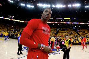 OAKLAND, CA - MAY 21:  Dwight Howard #12 of the Houston Rockets looks on before game two against the Golden State Warriors of the Western Conference Finals of the 2015 NBA PLayoffs at ORACLE Arena on May 21, 2015 in Oakland, California. NOTE TO USER: User expressly acknowledges and agrees that, by downloading and or using this photograph, user is consenting to the terms and conditions of Getty Images License Agreement.  (Photo by Ezra Shaw/Getty Images)