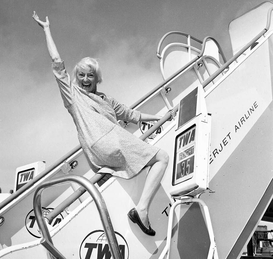 Phyllis Diller arrives in San Francisco on a TWA plane in 1964. Photo: Joe Rosenthal, The Chronicle