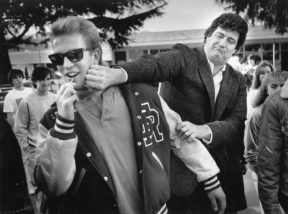"Michael Pritchard (1988): Pritchard visits students at San Rafael High School. I love the reaction on the face of this kid, who looks like a walking collage of ""Top Gun,"" ""All the Right Moves"" and ""Cobra."" Weren't we all ... Photo: Steve Ringman, The Chronicle"