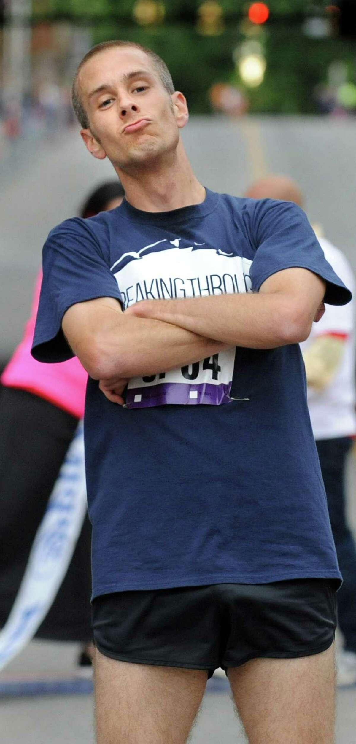 Kieran O'Connor of Tyler Technologies poses for the camera when he's the first man to cross the finish line during the CDPHP Workforce Team Challenge on Thursday, May 21, 2015, in Albany, N.Y. More than 10,000 runners and walkers signed up from 500-plus organizations. (Cindy Schultz / Times Union)
