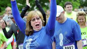 Participants cheer as their team name is called out during the CDPHP Workforce Team Challenge on Thursday, May 21, 2015, in Albany, N.Y. More than 10,000 runners and walkers signed up from 500-plus organizations. (Cindy Schultz / Times Union)