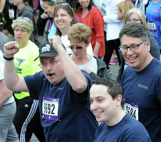 Participants cheer as their team name is called out during the CDPHP Workforce Team Challenge on Thursday, May 21, 2015, in Albany, N.Y. More than 10,000 runners and walkers signed up from 500-plus organizations. (Cindy Schultz / Times Union) Photo: Cindy Schultz / 00031895A