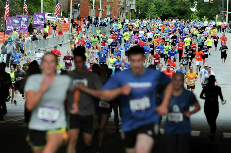 Participants race for the finish line during the CDPHP Workforce Team Challenge on Thursday, May 21, 2015, in Albany, N.Y. More than 10,000 runners and walkers signed up from 500-plus organizations. (Cindy Schultz / Times Union) Photo: Cindy Schultz / 00031895A