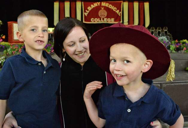 Kate Halligan of Albany with sons Sean, 7, left, and Ryan, 4, before the start of Albany Medical College's Commencement Thursday May 21, 2015 in Saratoga Springs, NY.  (John Carl D'Annibale / Times Union) Photo: John Carl D'Annibale / 00031912A