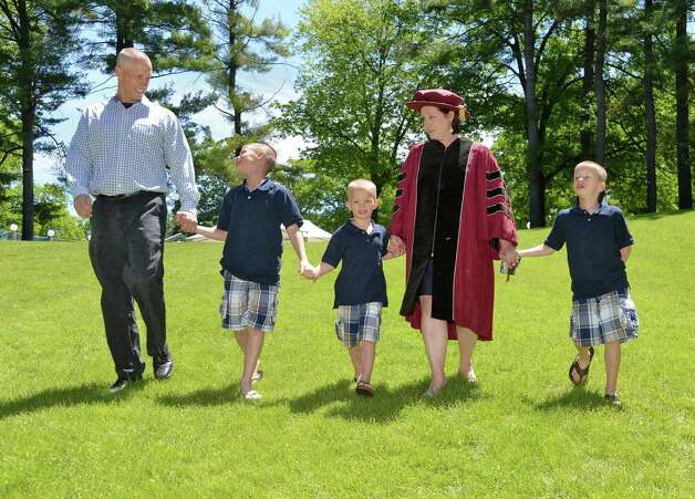 Kate Halligan of Albany with her family, from left, husband Stephen, sons Aidan, 10, Sean, 7, and Ryan, 4, arrive at SPAC for Albany Medical College Commencement and Kate's third degree there Thursday May 21, 2015 in Saratoga Springs, NY.  (John Carl D'Annibale / Times Union) Photo: John Carl D'Annibale / 00031912A
