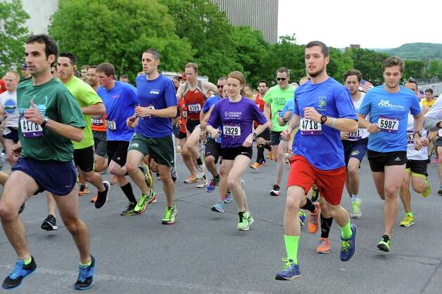 Participants run up Madison Avenue during the start of the CDPHP Workforce Team Challenge on Thursday, May 21, 2015, in Albany, N.Y. More than 10,000 runners and walkers signed up from 500-plus organizations. (Cindy Schultz / Times Union) Photo: Cindy Schultz / 00031895A