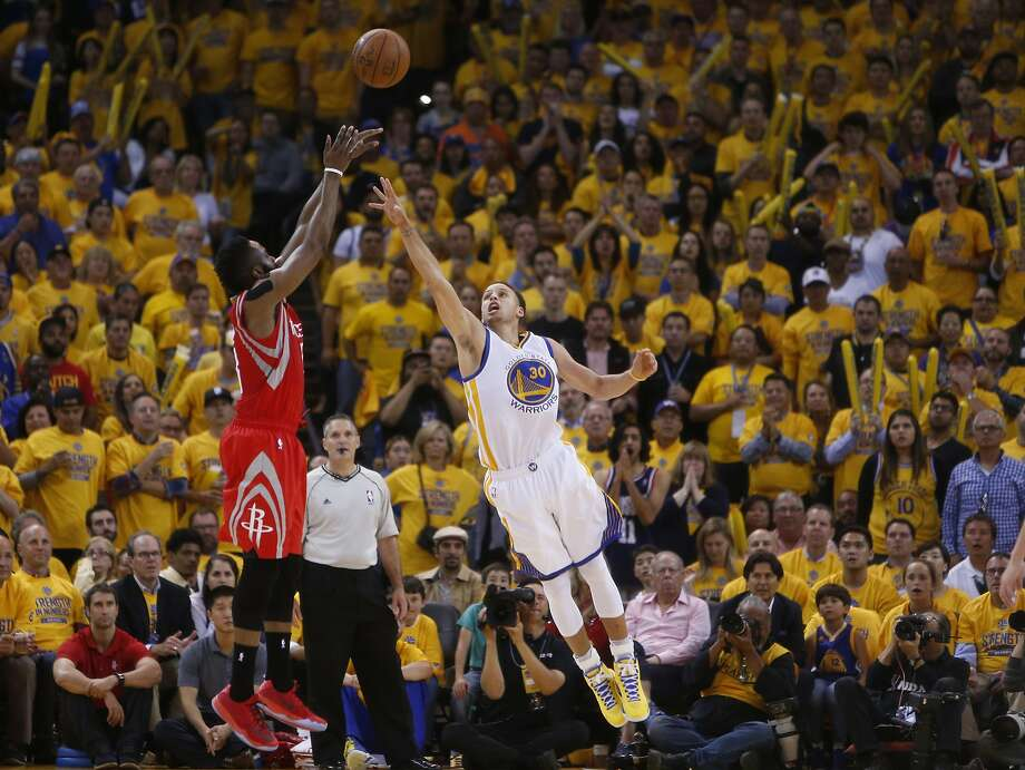 Houston Rockets James Harden shoots over Golden State Warriors Stephen Curry (30) in the second period during Game 2 of the Western Conference Finals on Thursday, May 21, 2015 in Oakland, Calif. Photo: Scott Strazzante, The Chronicle