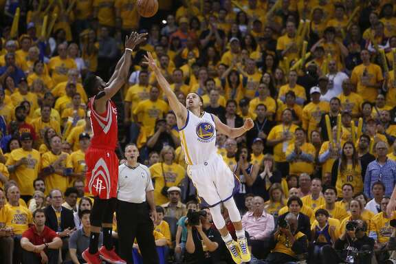 Houston Rockets James Harden shoots over Golden State Warriors Stephen Curry (30) in the second period during Game 2 of the Western Conference Finals on Thursday, May 21, 2015 in Oakland, Calif.