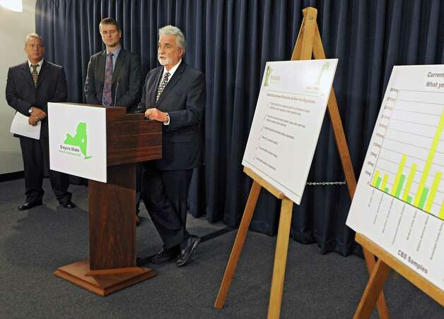 Michael Newell, chief operating officer of Empire State Health Solutions (ESHS), speaks at the Legislative Office Building as ESHS announces plans to produce cannabis-derived medications at a facility at the Tryon Technology Park and Incubator Center in Perth Thursday, May 21, 2015 in Albany, N.Y. Ralph Ottuso, chairman of the Fulton County Board of Supervisors, left, and Dr. Kyle Kinglsey, founder and CEO of ESHS, listen in background. (Lori Van Buren / Times Union) Photo: Lori Van Buren / 00031946A