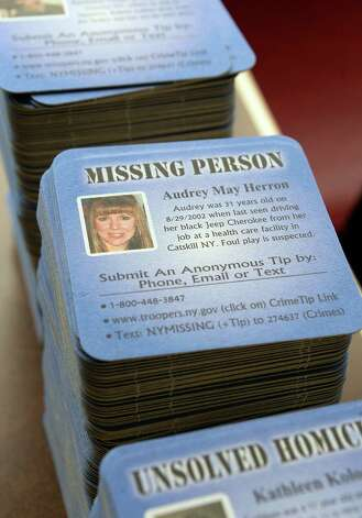 Stacks of new OCoasters for HopeO to help find Capital Region missing persons and find answers to several unsolved homicides launched during a news conference Thursday May 21, 2015 in Clifton Park, NY.  (John Carl D'Annibale / Times Union) Photo: John Carl D'Annibale / 00031932A