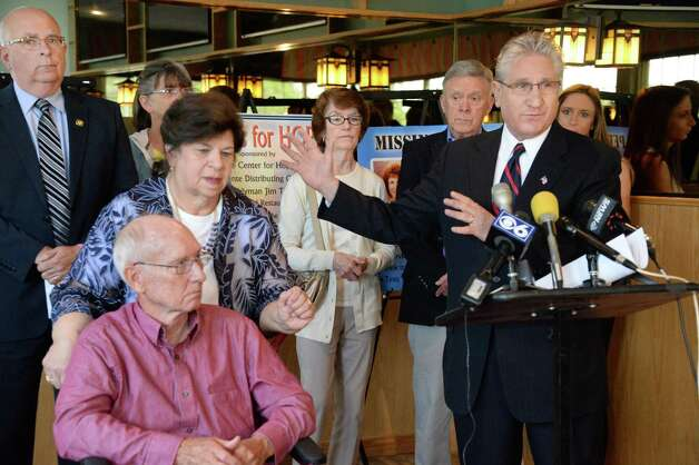 Assemblyman Jim Tedisco, right, joins Doug and Mary Lyall of the Center for Hope and DeCrescente Distributing Company to launch a new round of 8 Coasters for Hope to help find Capital Region missing persons and find answers to several unsolved homicides during a news conference Thursday May 21, 2015 in Clifton Park, NY.  At left is Saratoga County Sheriff Michael Zurlo.  (John Carl D'Annibale / Times Union) Photo: John Carl D'Annibale / 00031932A