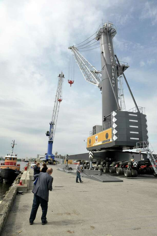 Large cranes are seen as attendees visit with each other during a break at the Port of Albany during the Albany Port District Commission 2nd Annual Port Industry Day on Thursday, May 21, 2015, in Albany, N.Y.   (Paul Buckowski / Times Union) Photo: PAUL BUCKOWSKI / 00031941A