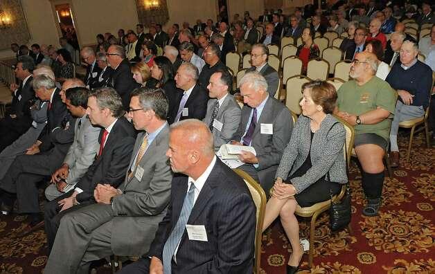People listen to Rob McCormick speak at the TrustCo Bank Corp NY annual shareholder's meeting at Mallozzi's Restaurant on Thursday, May 21, 2015 in Rotterdam, N.Y. (Lori Van Buren / Times Union) Photo: Lori Van Buren / 00031939A