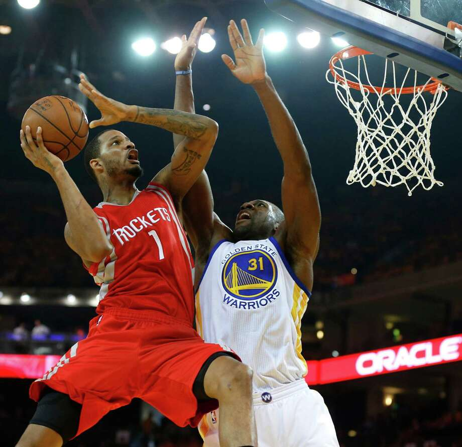 Rockets forward Trevor Ariza (1) goes up for a shot against Golden State's Festus Ezeli (31) in the first quarter of Thursday night's Game 2. Photo: James Nielsen, Staff / © 2015  Houston Chronicle