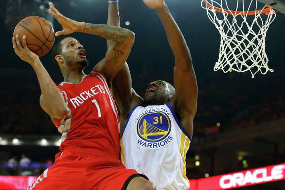 Rockets forward Trevor Ariza (1) goes up for a shot against Golden State's Festus Ezeli (31) in the first quarter of Thursday night's Game 2.