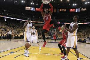 Houston Rocket Dwight Howard dunks in the second period during Game 2 of the Western Conference finals on Thursday, May 21 in Oakland, Calif.