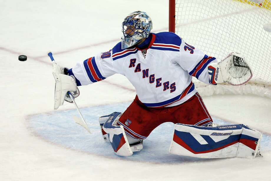 TAMPA, FL - MAY 20:  Henrik Lundqvist #30 of the New York Rangers makes a save in the first period against the Tampa Bay Lightning during Game Three of the Eastern Conference Finals during the 2015 NHL Stanley Cup Playoffs at Amalie Arena on May 20, 2015 in Tampa, Florida.  (Photo by Mike Carlson/Getty Images) ORG XMIT: 554342781 Photo: Mike Carlson / 2015 Getty Images