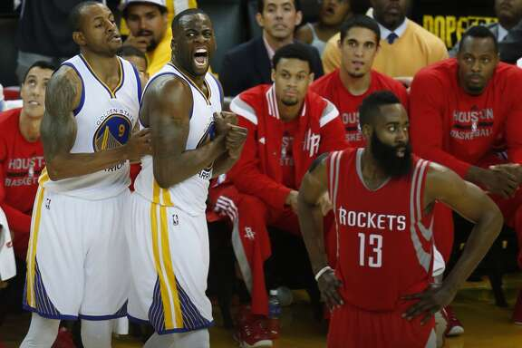 Golden State Warriors forward Draymond Green (23) and guard Andre Iguodala (9) react to scoring against the Houston Rockets as James Harden walks back up the court during the third quarter of Game 2 of the NBA Western Conference Finals at Oracle Arena on Thursday, May 21, 2015, in Oakland. ( Karen Warren / Houston Chronicle )