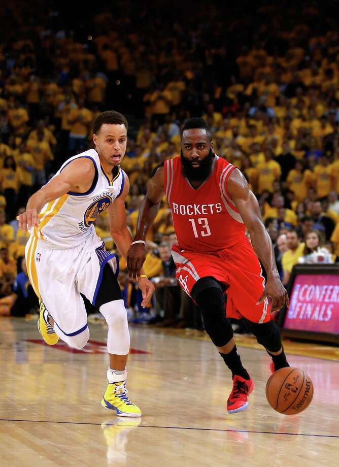 OAKLAND, CA - MAY 21:  James Harden #13 of the Houston Rockets handles the ball against Stephen Curry #30 of the Golden State Warriors in the second quarter during game two of the Western Conference Finals of the 2015 NBA PLayoffs at ORACLE Arena on May 21, 2015 in Oakland, California. NOTE TO USER: User expressly acknowledges and agrees that, by downloading and or using this photograph, user is consenting to the terms and conditions of Getty Images License Agreement.  (Photo by Ezra Shaw/Getty Images) ORG XMIT: 554941153 Photo: Ezra Shaw / 2015 Getty Images