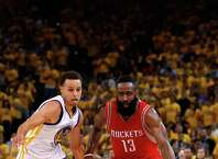 OAKLAND, CA - MAY 21:  James Harden #13 of the Houston Rockets handles the ball against Stephen Curry #30 of the Golden State Warriors in the second quarter during game two of the Western Conference Finals of the 2015 NBA PLayoffs at ORACLE Arena on May 21, 2015 in Oakland, California. NOTE TO USER: User expressly acknowledges and agrees that, by downloading and or using this photograph, user is consenting to the terms and conditions of Getty Images License Agreement.  (Photo by Ezra Shaw/Getty Images) ORG XMIT: 554941153