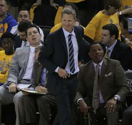 Coach Steve Kerr gets up during a break in the action during Game 2 of the Western Conference finals on Thursday, May 21 in Oakland, Calif.