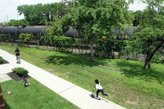 View of the courtyard between the apartment buildings and the rail line that carries oil tankers to the Port of Albany Wednesday, July 16, 2014, at Ezra Prentice Homes in Albany, N.Y. (Cindy Schultz / Times Union archive)