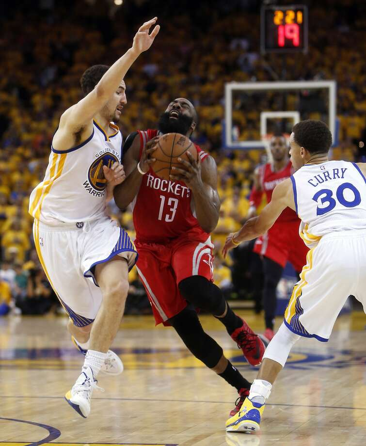 ec59e77e253f Golden State Warriors  Klay Thompson and Stephen Curry defend against  Houston Rockets  James Harden