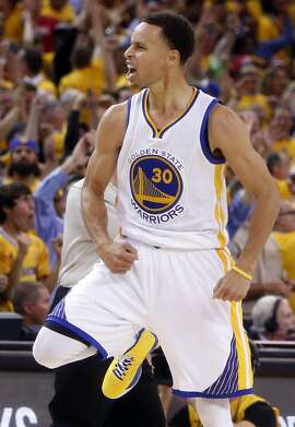 Golden State Warriors' Stephen Curry celebrates a 3-pointer in 4th quarter of Warriors' 99-98 win over Houston Rockets in Game 2 of NBA Playoffs' Western Conference Finals at Oracle Arena in Oakland, Calif., on Thursday, May 21, 2015.