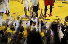 Stephan Curry conducts the crowd during the fourth quarter after a foul on Andrew Bogut, on Thursday, May 21, 2015 in Oakland, CA.