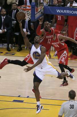 Harrison Barnes (40) tries to shoot in the fourth quarter but misses the Warriors' last shot as Golden State played the Houston Rockets in Game 2 of the Western Conference finals at Oracle Arena in Oakland, Calif., on Thursday, May 21, 2015. The Warriors defeated the Rockets 99-98.