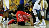Houston Rockets guard James Harden (13) falls to the floor after not being able to get a shot off against the Golden State Warriors as time ran out in the fourth quarter of Game 2 of the NBA Western Conference Finals at Oracle Arena on Thursday, May 21, 2015, in Oakland. Golden State Warriors won Game 2 99-98.