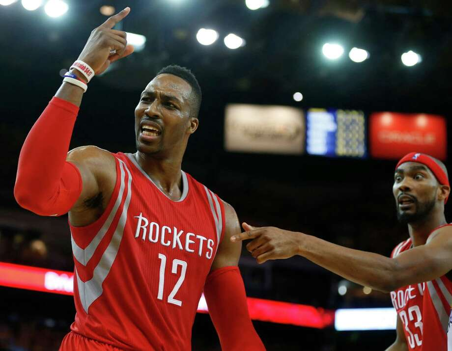 A fourth-quarter call leaves the Rockets' Dwight Howard, left, and Corey Brewer incredulous. Photo: James Nielsen, Staff / © 2015  Houston Chronicle