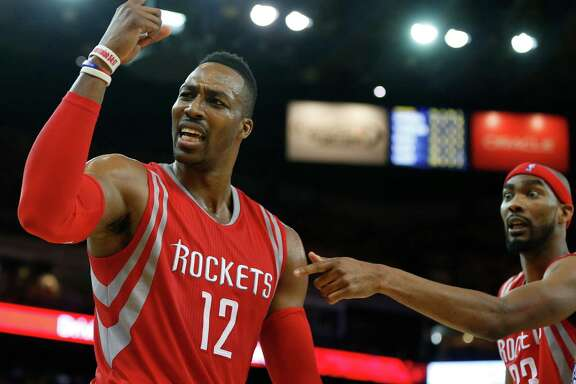 A fourth-quarter call leaves the Rockets' Dwight Howard, left, and Corey Brewer incredulous.