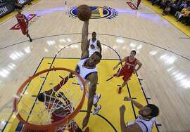 Golden State WarriorsÕ Andre Iguodala (9) dunks in the second period  during Game 2 of the Western Conference Finals on Thursday, May 21, 2015 in Oakland, Calif.