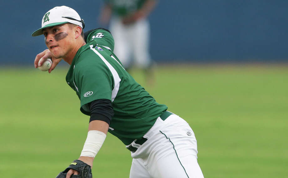 Rattlers second baseman Andres Sosa leans over to make the throw to first for an out in the first inning as Reagan plays Smithson Valley in Game 1 of the third round of Class 6A high school baseball playoffs on May 21, 2015. Photo: Tom Reel /San Antonio Express-News