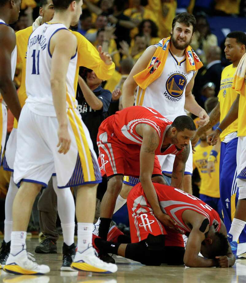The Warriors' Stephen Curry, left, and Klay Thompson put James Harden in a bind in the final seconds, with the Rockets failing to get off a last shot while trailing by one point. That left Curry celebrating, below left, and the Rockets' Trevor Ariza consoling Harden, below right. Photo: James Nielsen, Staff / © 2015  Houston Chronicle