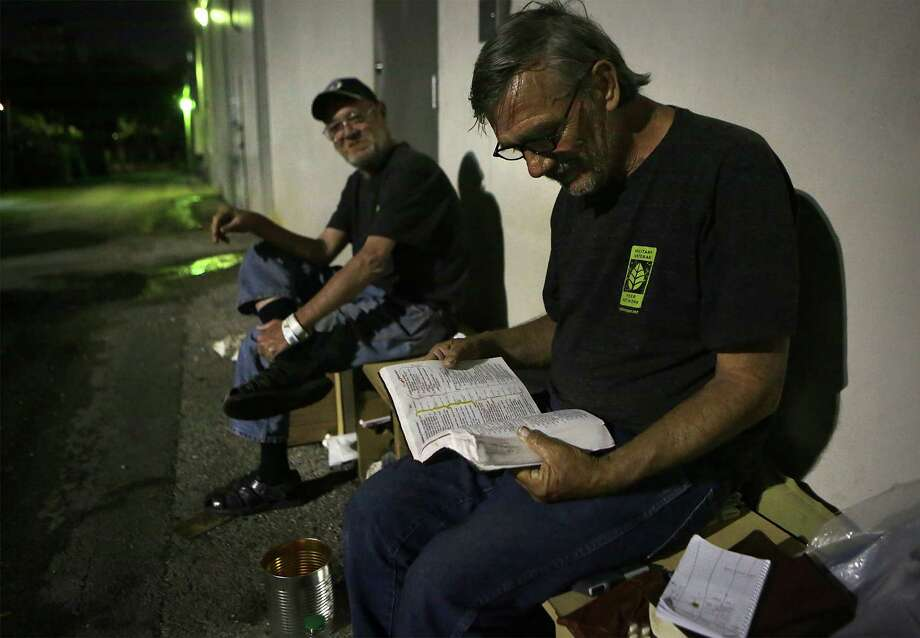 Paul, right, and Russell, two veterans who were living behind a strip mall in the Med Center area which is close to the Veterans Hospital, before they were told to leave the area on Monday, March 23, 2015. Photo: Bob Owen, Staff / San Antonio Express-News / © 2015 San Antonio Express-News