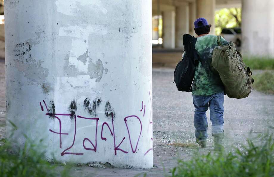 This 2014 file photo shows a homeless man in San Antonio. The Obama adminsitration has argued that anti-camping laws crimininalize homelessness and are cruel and unusuual punishment. Photo: BOB OWEN /San Antonio Express-News / © 2014 San Antonio Express-News