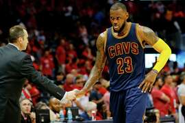 LeBron James is congratulated by Cavaliers coach David Blatt after Cleveland's Game 1 victory.