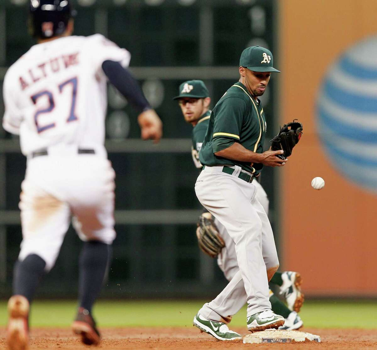 Marcus Semien, who drops a flip from Eric Sogard on a force play against Houston on Monday, has struggled as the everyday shortstop for the Athletics. Ron Washington, the former Texas Rangers manager who has been hired by the A's as a special assistant, will work with Semien. He tutored shortstop Miguel Tejada as the A's infield coach a decade ago.