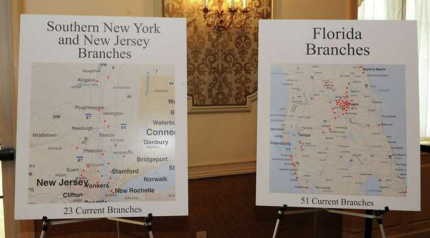 Signs showing branch locations in Southern New York, New Jersey and Florida at the TrustCo Bank Corp NY annual shareholder's meeting at Mallozzi's Restaurant on Thursday, May 21, 2015 in Rotterdam, N.Y. (Lori Van Buren / Times Union) Photo: Lori Van Buren / 00031939A