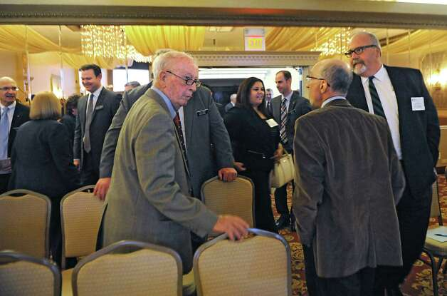 People mingle before the TrustCo Bank Corp NY annual shareholder's meeting at Mallozzi's Restaurant on Thursday, May 21, 2015 in Rotterdam, N.Y. (Lori Van Buren / Times Union) Photo: Lori Van Buren / 00031939A